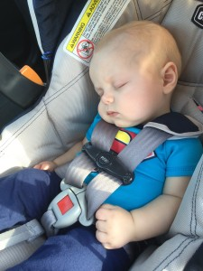 Sleeping baby wearing Superman onesie